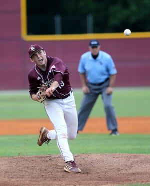 Benedictine pitcher Carter Holton works from the mound during Game 2 of the GHSA Class 4A  state quarterfinal doubleheader against visiting Heritage on Monday.