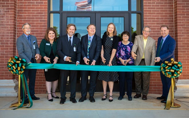 Cutting, Left to right: Sam Garlow, chair of the OBU Board of Trustees; Dr. Susan DeWoody, provost; OBU President Dr. Heath A. Thomas; Dr. Chris Jones, dean of the Hurley College of Science and Mathematics; Dr. Pam Robinson, director of teacher education; Elisa Cooper, donor; Ted Cooper, donor; and Tim Rasnic, vice president for advancement.