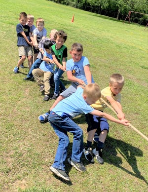 Liberty students compete in a tug-of-war at the school's first Olympics May 7.