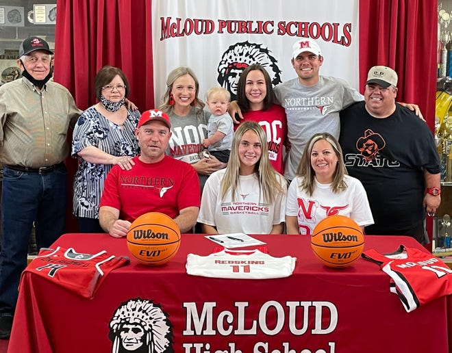 McLoud High School basketball player Lexie Boyer (seated center) recently signed a letter-of-intent with Northern Oklahoma College in Tonkawa. Seated with Lexie are her parents Kevin and Susan Boyer. Standing are: (from left to right) Paul Higdon, Jane Higdon, Rachael Boyer holding Asher Boyer, Ashley Boyer, Tim Boyer and Jimmy Higdon.