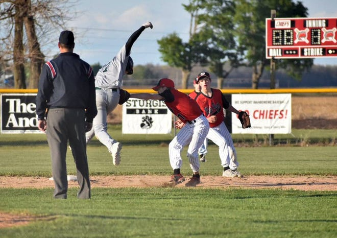 Yzack Hagen of White Pigeon tags out a Hartford base-runner in baseball action Monday.