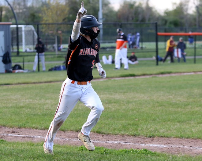 Shayne Quersher raises his hand in victory after his game-winning hit.