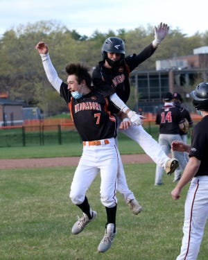 Middleboro's Shayne Quersher celebrates with teammate Jake Dagesse after his game-winning hit Friday at Middleboro High School. Quersher's hit gave Middleboro the run they needed for a 3-2 win over visiting Durfee.