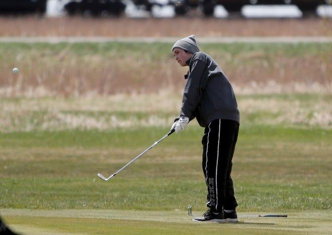 Sisseton golfer Kelsey Heath chips near the fourth hole at Monday's Groton Invitational. American News photo by Jenna Ortiz, taken 05/10/2021.