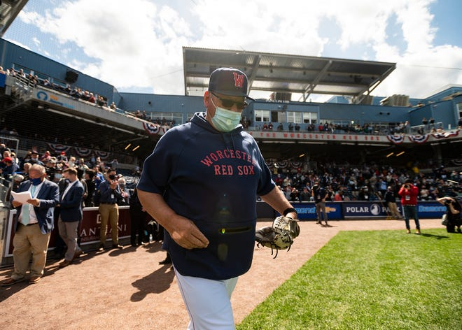 Worcester Red Sox hitting coach Rich Gedman walks on the field to throw one of the ceremonial first pitches at Polar Park during last week's Opening Day festivities.