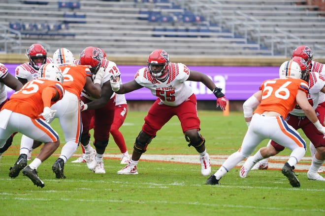 Offensive lineman Tyrone Riley (55) blocks during a Oct. 10 game against Virginia. Due to a series of injuries during his college career, Riley will suit up for his seventh season in 2021.