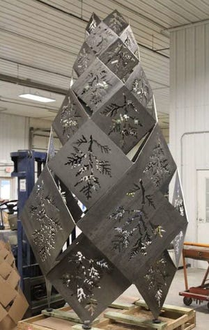 A metal sculpture by James Gabbert, that will be placed outside the new University of Florida Institute of Food and Agricultural Sciences extension office after commissioners voted for the design Tuesday. [Courtesy of Alachua County]