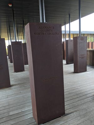 Alamance County's is one of many memorial slabs at the Peace and Justice Memorial in Montgomery, Alabama. Alocal group of organizers and volunteers hopetheir work with Alabama's Equal Justice Initiative will spread awareness ofthe county's lynching history.