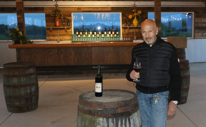 Breitenbach Winery owner Duke Bixler stands inside Dusk -- Wine and Fire Bar, scheduled to open May 28. The outdoor venue is at 5773 Old Route 39 NW west of Dover. Jim Cummings/Times-Reporter
