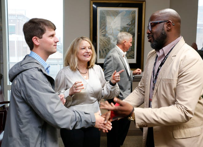 Outgoing Tuscaloosa City Council President Cynthia Almond introduces her son Miller to LaParry Howell during a reception Tuesday. Tuscaloosa bade farewell to three city council members prior to the council meeting May 11, 2021. [Staff Photo/Gary Cosby Jr.]