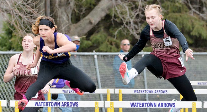 Watertown's Katelyn Hanson (second from left) and Milbank Area's Nadia Schneck (7) and Elsie Seffrood (5) compete in the girls' 100-meter hurdles recently in the Watoma Relays track and field meet at Watertown. Milbank Area and other area athletes will compete Thursday in the Northeast Conference meet at Groton the the Arrows will head to Aberdeen Saturday for the Eastrn South Dakota Conference meet.