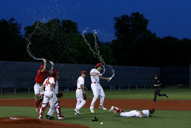 Maypearl baseball players begin their after-game celebration after earning a bi-district series sweep over Paradise on Friday at Fort Worth Arlington Heights. The Panthers advance to face Emory Rains next.