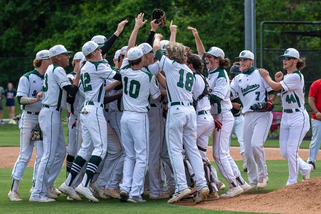 Waxahachie baseball players celebrate a sweep on their home diamond after they finished off Killeen Harker Heights, 4-0, on Saturday at Richards Park in the Class 6A Region II bi-district round.