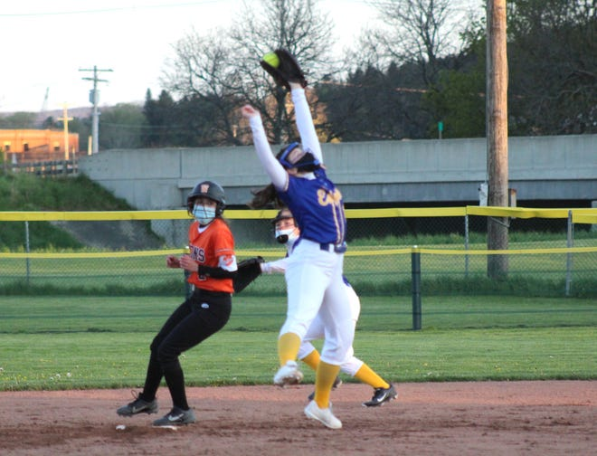Alfred-Almond shortstop Jessica McMahon makes a leaping catch as Wellsville's Carley Young reaches second for a stolen base Monday night.