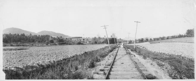 The Beaver Lake site in 1910 was called Baird's Bottom and provided the bed for the section of the Asheville & East Tennessee Railroad between Asheville and Weaverville.