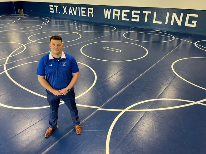 Brandon Dean is the new wrestling coach at St. Xavier
