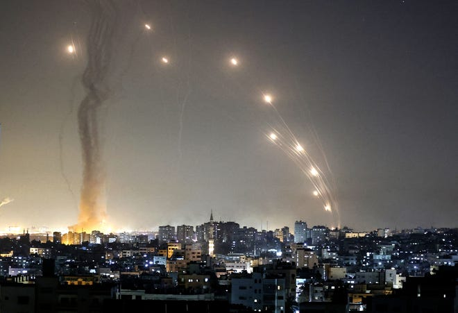 Hamas and Islamic Jihad have exploited Palestinian unrest to launch rockets at Israel from Gaza City, the authors write.