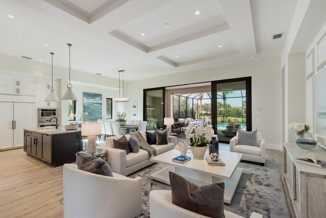 The Devonshire is an entertaining oasis, with a formal dining room and a generous great room that opens to an outdoor living space complete with a kitchen, pool and spa.