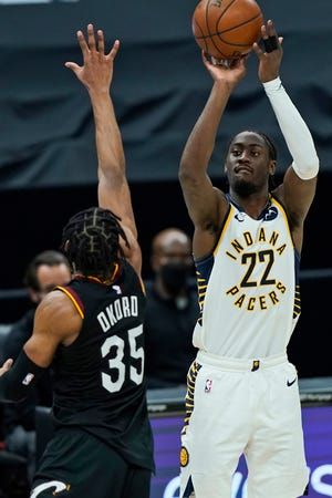 Indiana Pacers' Caris LeVert (22) shoots over Cleveland Cavaliers' Isaac Okoro (35) in the second half of an NBA basketball game, Monday, May 10, 2021, in Cleveland.