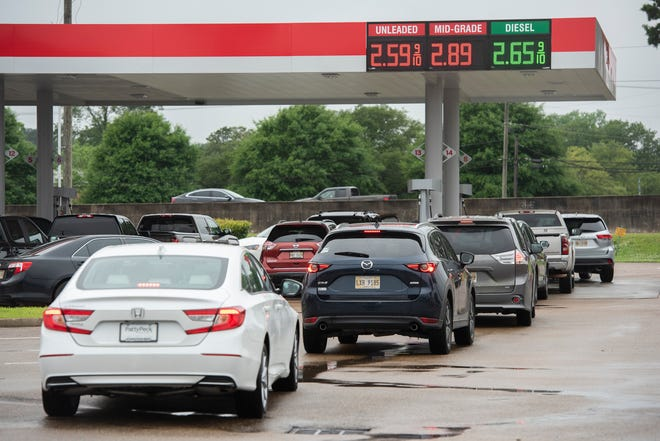 Drivers line up to fill their tanks with gas at the Kroger on I-55N frontage Road in Jackson, Miss., Tuesday, May 11, 2021, after a Friday ransomware attack shut down the Colonial Pipeline, a critical artery for gasoline in the southeast United States.