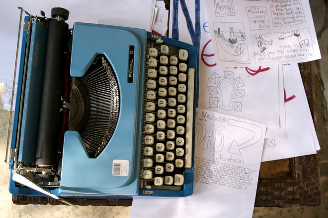 A Royal typewriter sits on a table surrounded by drafts of Neighborhood News, a weekly newspaper created by neighbors Izzy Bechler, William Foote and Rebecca Foote, Friday, May 7, 2021 in West Lafayette.