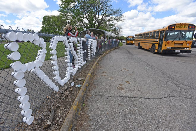 Lexington school buses form a parade and pass by Western Elementary in honor of Rosie McDaniel.