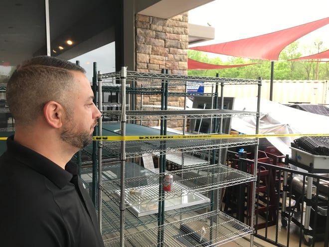 Valon Arifi outside Brick Oven Pizzeria in Mt. Juliet's Valley Center that he owns with his wife. The restaurant had to close after flooding to the Valley Center in March with equipment outside as repairs are done inside.