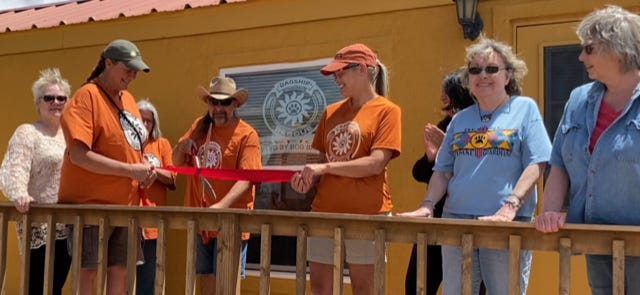 Members of the Deming Animals Guardians and the DAGship No-Kill Animal Rescue and Sunshine Haven Intake Project joined with Deming-Luna County Chamber of Commerce members April 30, to officially cut the ribbon to the animal rescue facility.