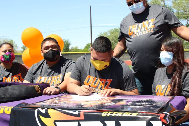 Kirtland Central's Sheldon Benally signs his national letter of intent on Tuesday, May 11, 2021, to continue his football career at NAIA's Ottawa University-Arizona in Surprise, Arizona.
