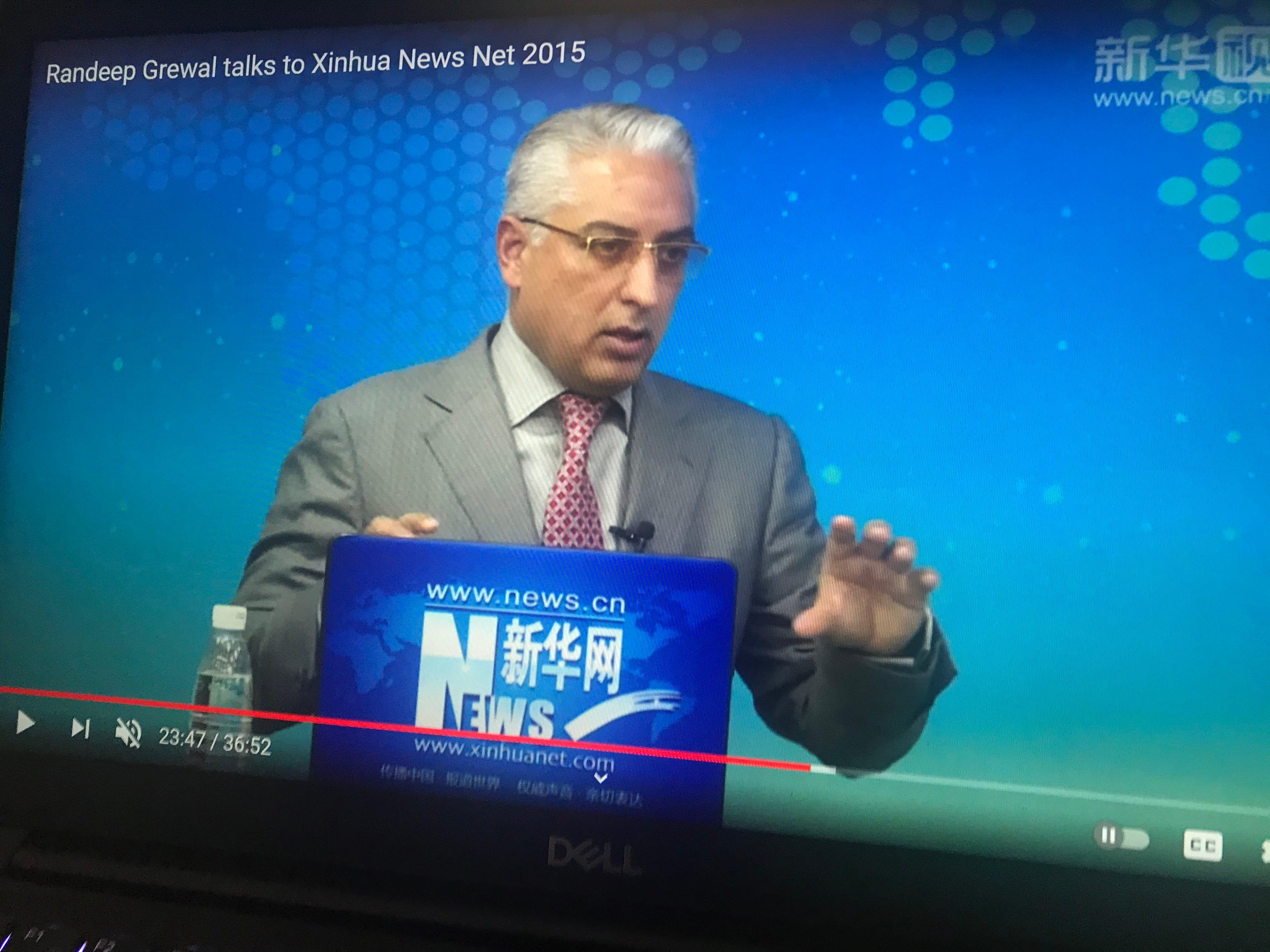 In this screenshot, Randeep Grewal appears on a Chinese state-run Xinhua News program.