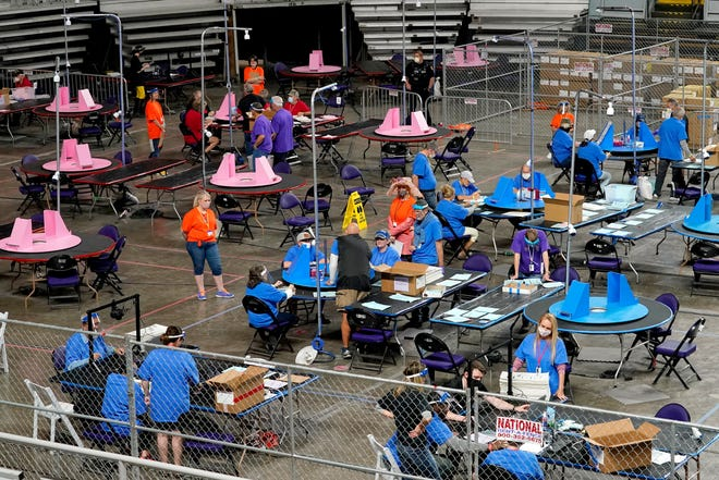 Maricopa County ballots cast in the 2020 general election are examined and recounted by contractors working for Florida-based company, Cyber Ninjas, Thursday, May 6, 2021, at Veterans Memorial Coliseum in Phoenix.