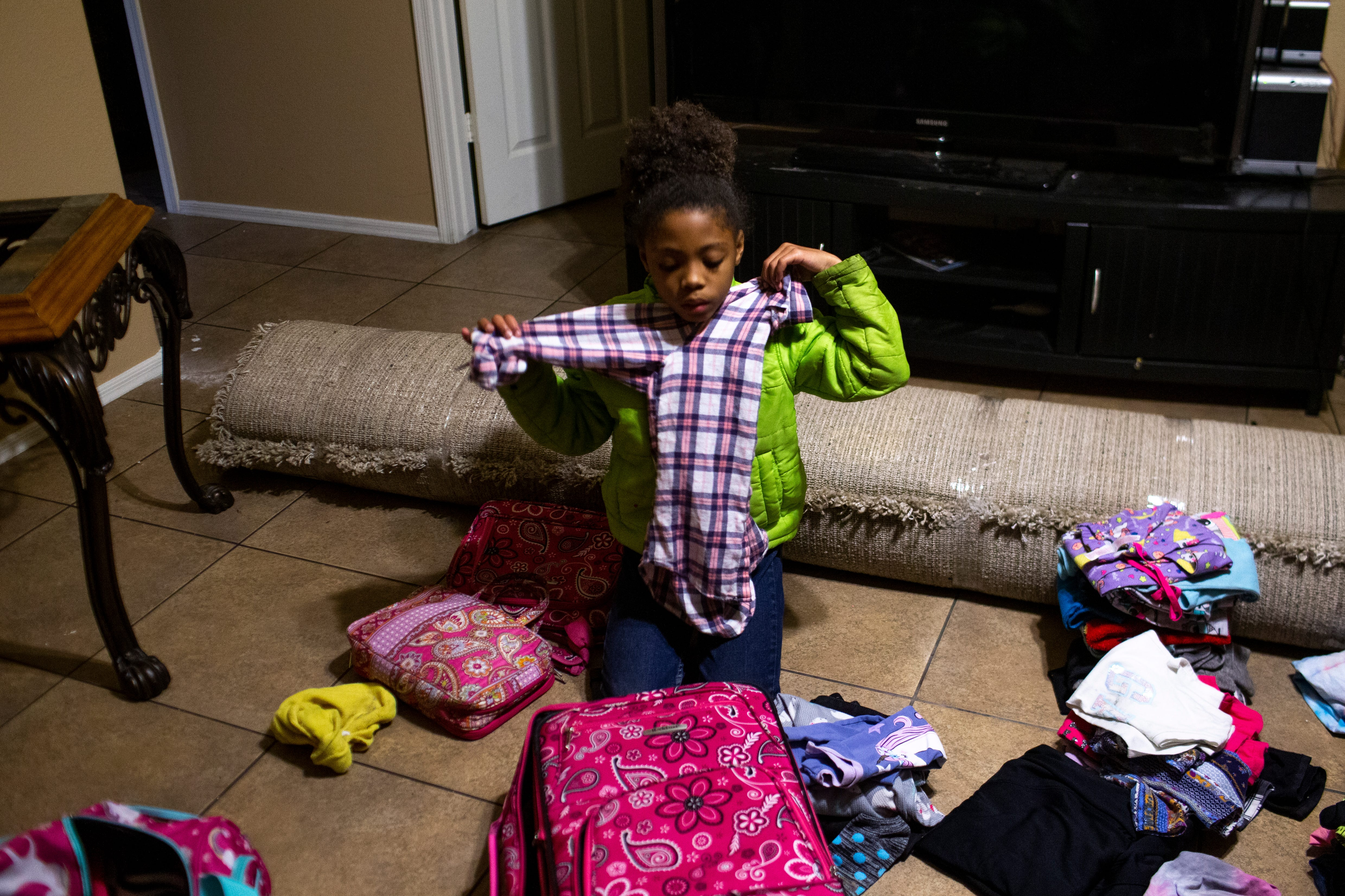 Khalia Rowe-Haysbert, 9, packs her clothes before leaving on a flight to stay with family in California after her grandmother Sylvia Haysbert-Stevens, whom she had been living with, was ordered to be evicted from her rental home in El Mirage on March 11, 2021. Despite a moratorium preventing landlords from evicting tenants during the COVID-19 pandemic, a court ordered Stevens to vacate the El Mirage home she had been living in with her daughter and granddaughter.