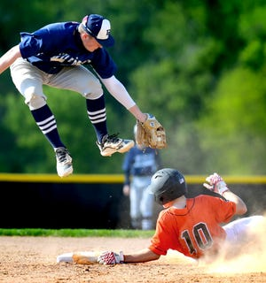 Dallastown's Riley Thomas reaches for a tag after snagging a high throw on a successful steal attempt by Central York's Ethan Hall during action at Central Monday, May 10, 2021. The Wildcats earned a 12-6 road win. Bill Kalina photo