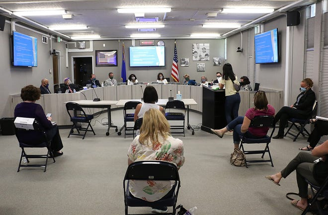 People wait to speak during the public comment section of the Washoe County School Board meeting at their headquarters in Reno on May 11, 2021.