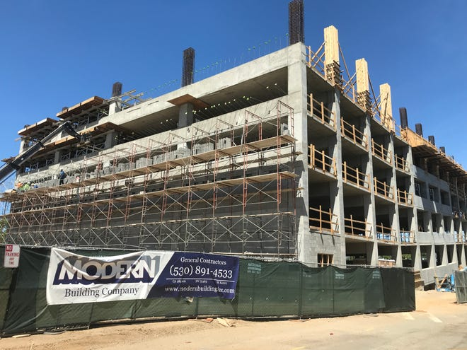 Work continues on the first phase of Block 7, a six-story parking garage, on May 11, 2021. The new parking garage is expected to be finished in the fall or early winter 2021.