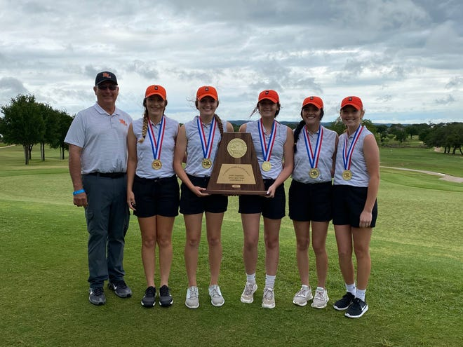 Robert Lee High School head coach Kerry Gartman and the Lady Steers celebrate after winning the UIL Class 1A state golf title Tuesday in Kingsland. The Lady Steers defended their 2019 title after not getting the chance to last year due to COVID-19. The players, from left to right, are: Abigayle Smith, Braylee Hood, Jade Arens, Mia Galvan and Mackenzie Galicia.