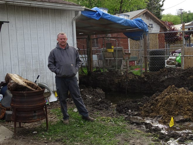 Skip Birkhimer rents a house on Galena Avenue. On Saturday, his yard became filled with rainwater and potentially sewage after he says a sewer pipe burst behind his home on Brown Alley.