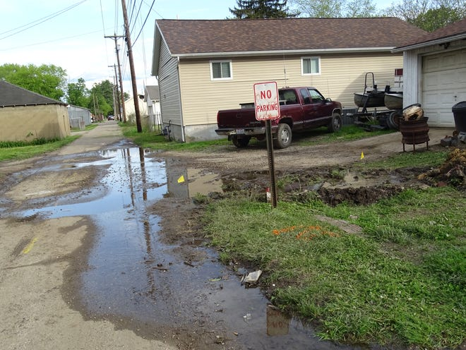 The Muskingum County Sewer Department patched a sewer hole on Tuesday in Brown Alley.