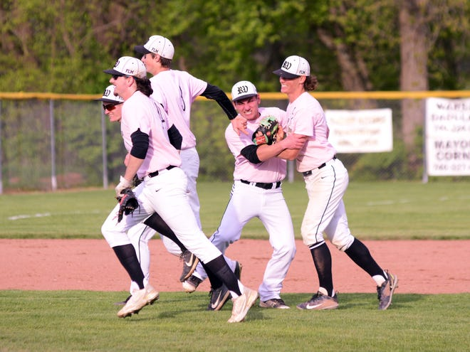 River View players celebrate a 4-1 win against Sheridan on May 10 at Ron Tisko Field in Warsaw.
