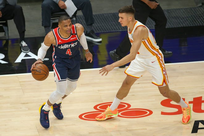 Washington Wizards guard Russell Westbrook looks to drive past by Atlanta Hawks guard Bogdan Bogdanovic (13) during a May 10 game.