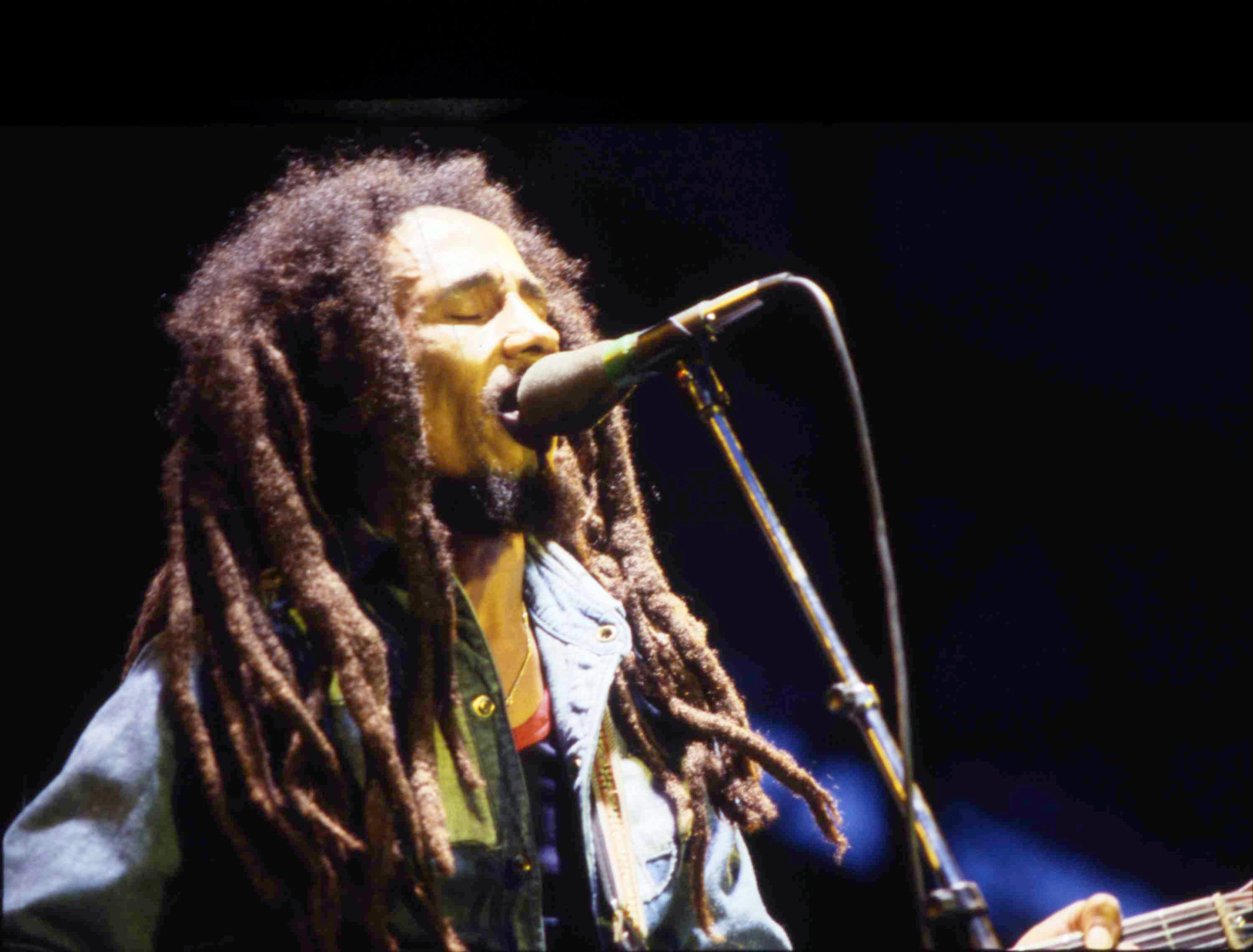 Jamaican reggae icon Bob Marley performs on stage during a concert in Bourget, Paris, on July 3, 1980. A recurrent theme in reggae music and Rastafarianism, the idea that half of history has been censored or omitted, generated a concept for USA TODAY's 2021 Never Been Told project.