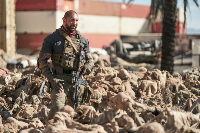 """Scott Ward (Dave Bautista) trudges through the remnants of a zombie outbreak for a daring Las Vegas casino heist in """"Army of the Dead."""""""