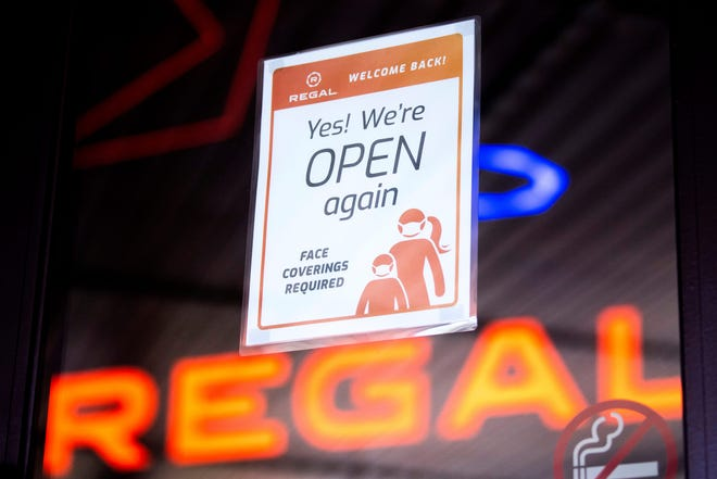 A sign hangs on a door to the Regal Pinnacle theater in Knoxville, Tenn., on Friday, April 2, 2021.