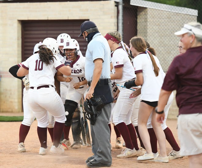 Bastrop's Christina Salinas crosses home plate and sparks a celebration from her teammates during the 2021 season. Salinas was recently named to the District 18-5A softball first team.