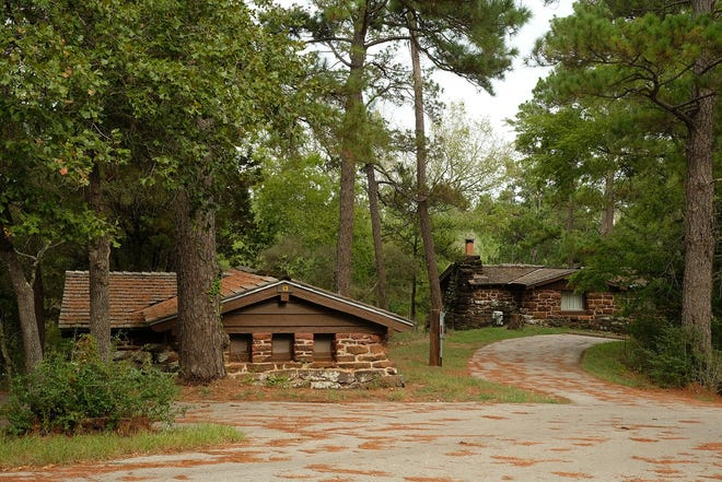 """The historic cabins in Bastrop State Park survived the 2011 fires. The Texas Parks and Wildlife Department in March began """"a strategic and thoughtful process"""" of expanding capacity in state parks, and most of them, including Bastrop State Park, are now open for camping and day visits."""