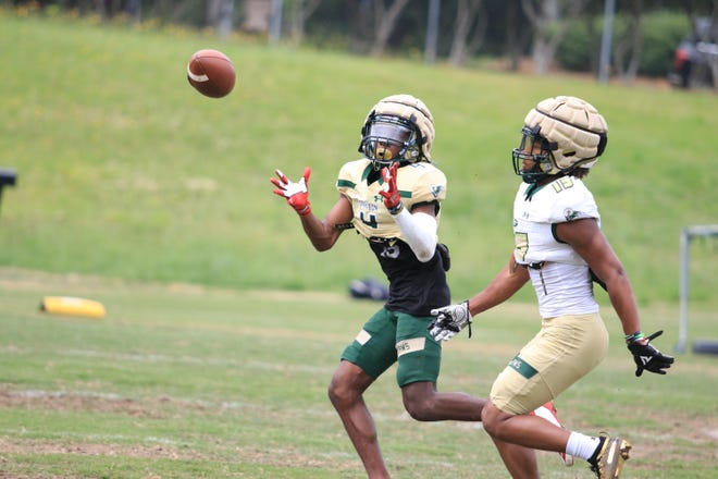 Rising freshman Jaylen Bell intercepts a pass during Grayson's spring practice on Tuesday.