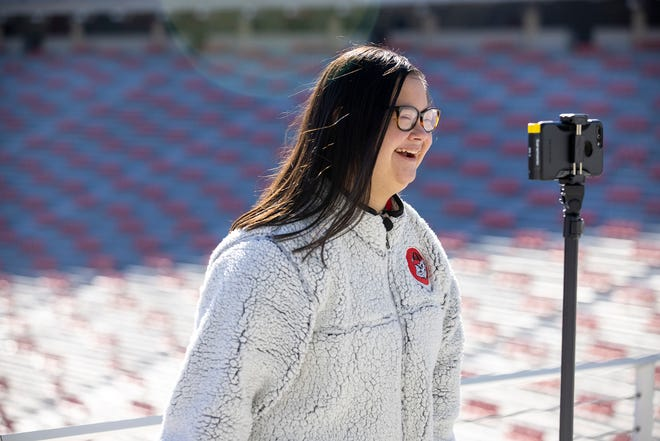 Marina Martinez records video for her vlog at Sanford Stadium. Marina is an intern in the Institute of Human Development and Disability.