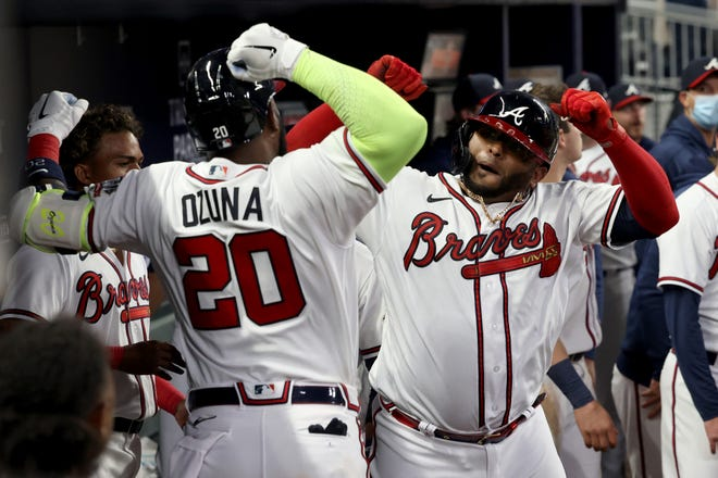 Atlanta Braves third baseman Pablo Sandoval (48) celebrates his two run home run with outfielder Marcell Ozuna (20) during the ninth inning against the Philadelphia Phillies at Truist Park. Mandatory Credit: Jason Getz-USA TODAY Sports