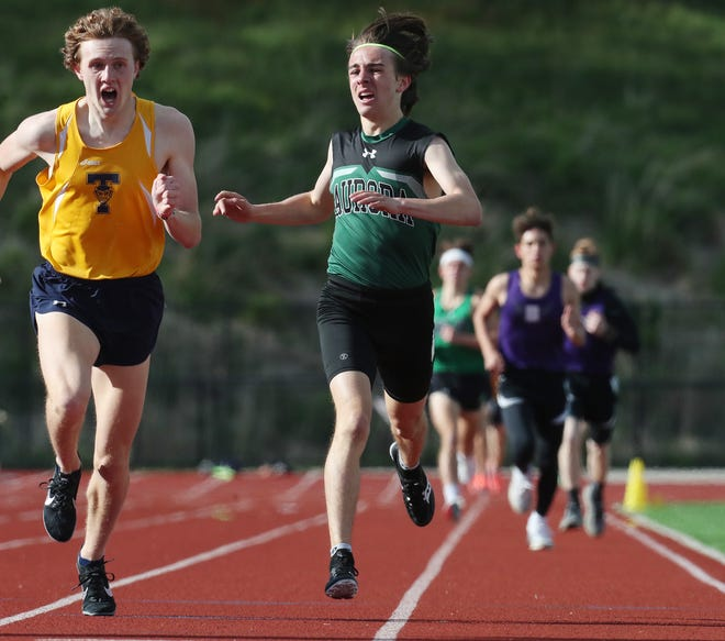 Aurora's Matt Singleton, right, is shown an earlier race. He finished second in the 1600 meters at the Division I district championships.