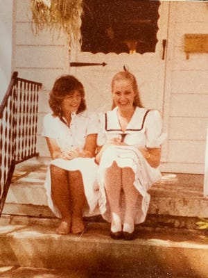 Holly Christensen sits with her childhood best friend, Kelly O'Brien.